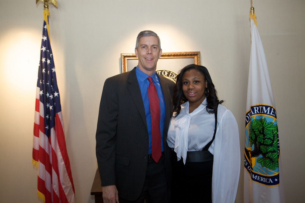 Mary-Pat poses with Arne Duncan