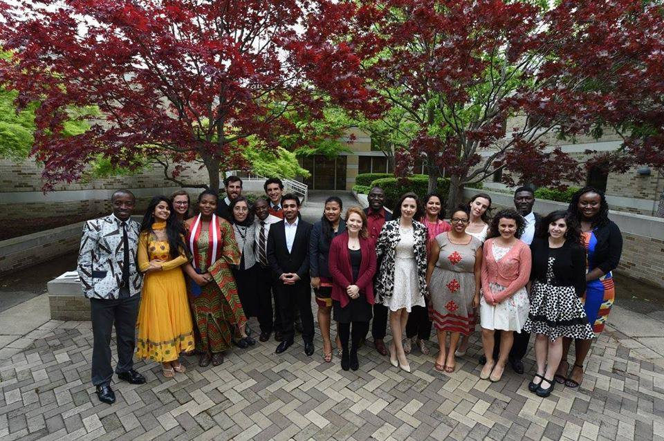 A large group of young students in formal wear