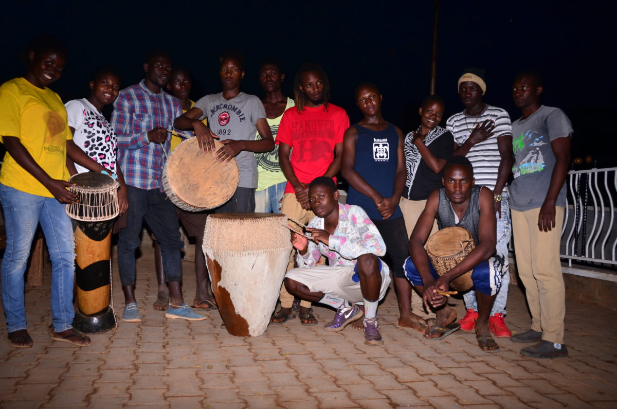 A group of young people with drums