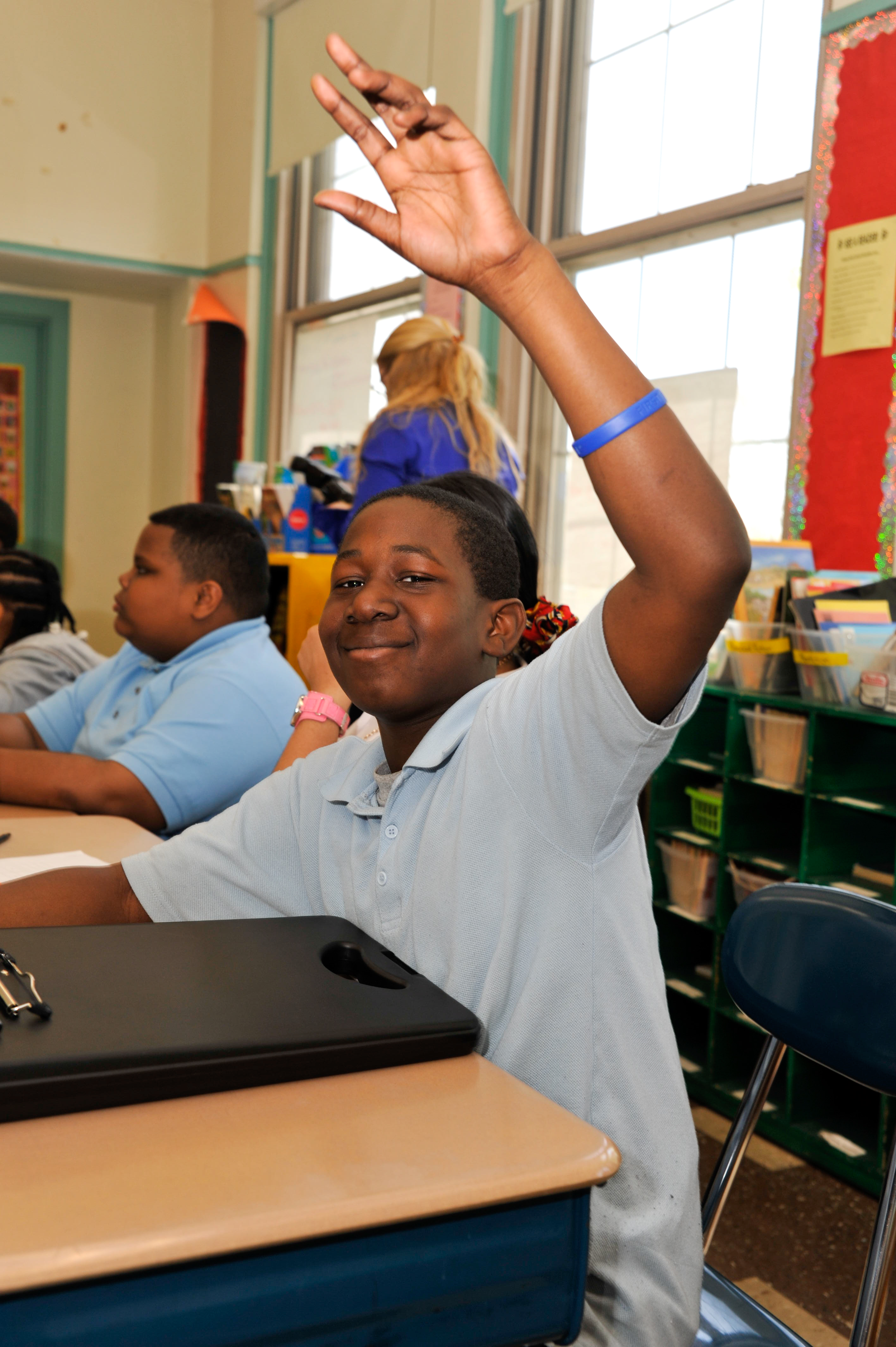 Peace First student raising his hand