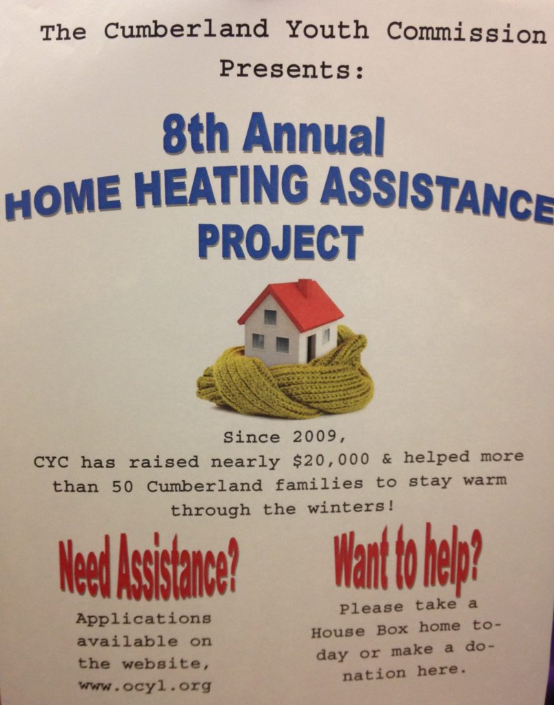 "A poster reading ""8th annual home heating assistance project"""