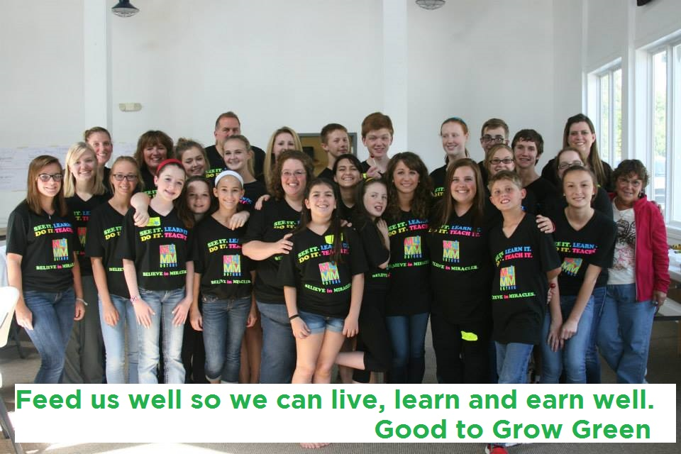 "A group of young people that reads ""feed us well so we can live, learn, and earn well -- good to grow green"""