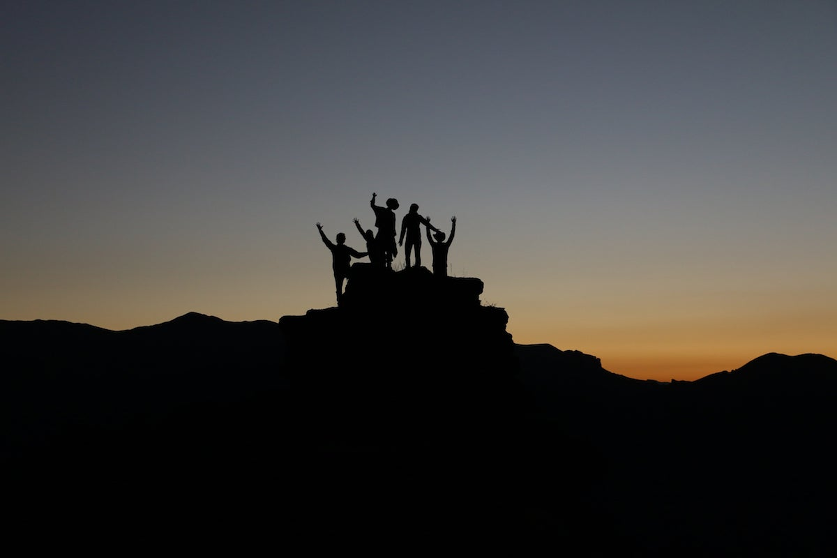 Young people on top of mountain