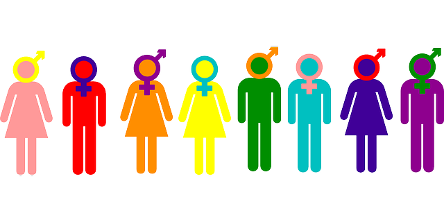 A drawing of people who are all the colors of the rainbow, with different gender symbols over their heads