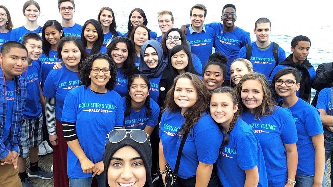 Young People Taking a Selfie in Blue T-shirts