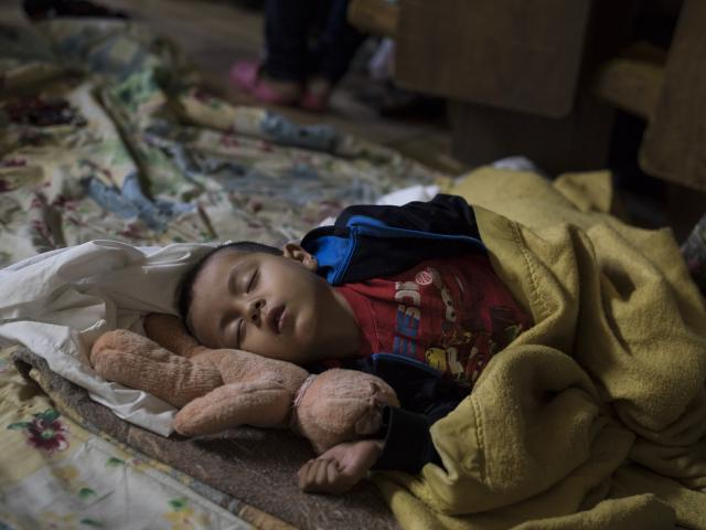 Migrant child in a shelter