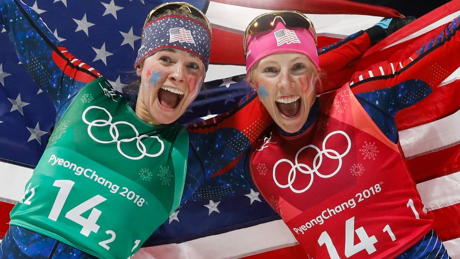 Jessica Diggins and Kikkan Randall celebrate winning their gold medals at the Winter Olympics