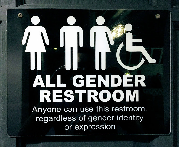 A sign posted outside a gender-neutral bathroom at a restaurant, taking a stance against LGBTQ discrimination.