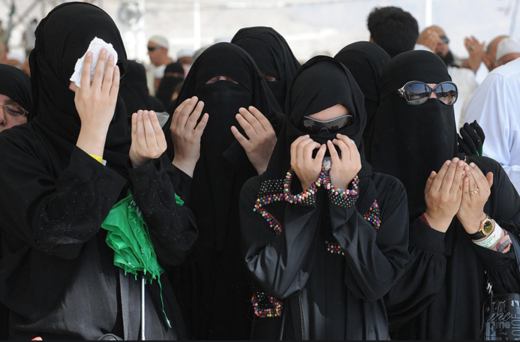 Women in Saudi Arabia following the Islamic country's strict, conservative dress code. PHOTO CREDITS: Fayez Nureldine/AFP/Getty Images