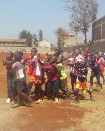 This is a picture taken while kids were celebrating a goal scored, soccer is a powerful tool enabling peace.