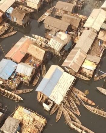 The image shows an aerial view of the makoko community.