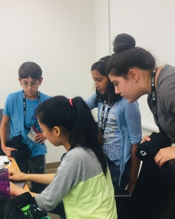 Here we have a team of girls working to develop a solution for a problem in their community using skills from our coding camp.