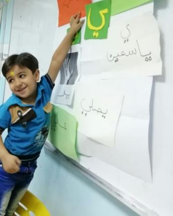 this photo is taken from an education activity conducted  in Jordan which was about drops out children.