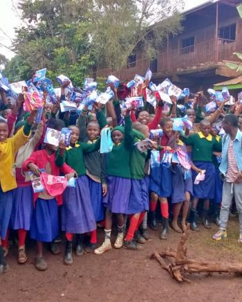 Happy Muthiga primary school girls after we donated reusable AFRIpad menstrual kits.
